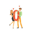 happy couple in love holding red letter o vector image vector image