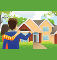 couple looking at a house vector image