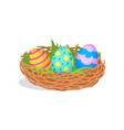 three painted easter eggs in brown nest with green vector image vector image