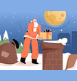 santa claus is holding presents and standing vector image
