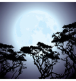 big blue moon and silhouettes of tree branches vector image