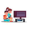 boy and girl playing video games together vector image