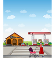A mother walking along a garage and gasoline vector image