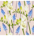 Freesia and muscari seamless background vector image
