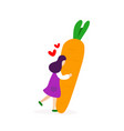 young girl hugging with big carrot vector image