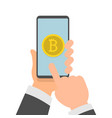 hands holding phone with bitcoin icon on screen vector image