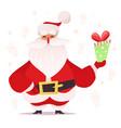 santa claus holding a gift vector image