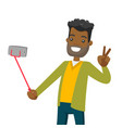 a black man making selfie on his cellphone with a vector image vector image
