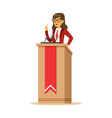young politician woman standing behind rostrum and