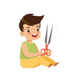 boy playing with scissors kid in dangerous vector image