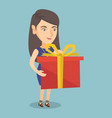 young caucasian woman holding a box with gift vector image vector image