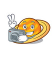 photographer planet saturnus mascot cartoon vector image
