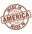 made in america brown grunge round stamp vector image vector image