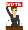 woman waved her hand standing behind the tribune vector image