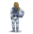 female astronaut with helmet in hand back view vector image