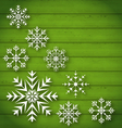 Set geometric snowflakes on wooden background vector image vector image