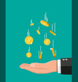 falling gold coins and hand money rain vector image vector image