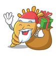 santa with gift exotic shell mascot cartoon vector image
