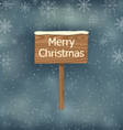 snow covered wooden sign Merry Christmas vector image