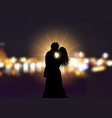silhouette of a loving couple on bokeh lights vector image vector image