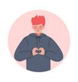 teen boy making heart hand gesture teenager vector image vector image