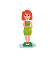 pregnant woman character standing on weighing vector image