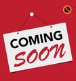 a business sign that says coming soon vector image