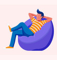 young man sitting and chilling on bean bag vector image