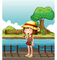 A girl eating an ice cream at the bridge vector image vector image