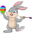 cartoon rabbit painting an easter egg vector image vector image