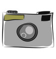 Simple grey photo camera on white background