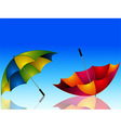 Umbrella and reflection on dark blue background vector image vector image