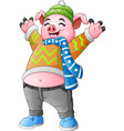 cartoon happy pig in winter clothes vector image vector image