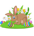 cartoon bunny with easter egg on grass vector image vector image