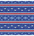 blue knitted seamless pattern with red and white vector image vector image