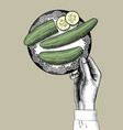 female hand holding a plate with green cucumbers vector image vector image