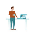man standing at his workplace and drink coffee vector image