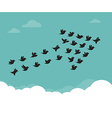 Flock of birds flying in the sky in an arrow vector image