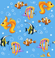 seamless pattern with colorful tropical fishes vector image