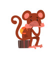 funny monkey sitting on a suitcase cute animal vector image vector image