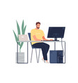 man working with laptop and computer at desk vector image