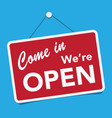 a business sign that says come in were open vector image