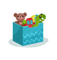 blue box full of children toys brown teddy bear vector image