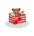 striped box with red bow full of children toys vector image vector image