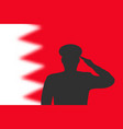 solder silhouette on blur background with bahrain vector image vector image