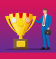 successful businessman near big gold trophy cup vector image vector image