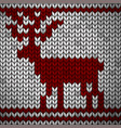 white knitted fabric with a red ornament and deer vector image