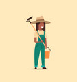female gardener holding hoe and bucket african vector image vector image