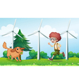 A boy playing with his dog near the windmill vector image vector image
