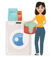 housewife washes clothes in the washing machine vector image